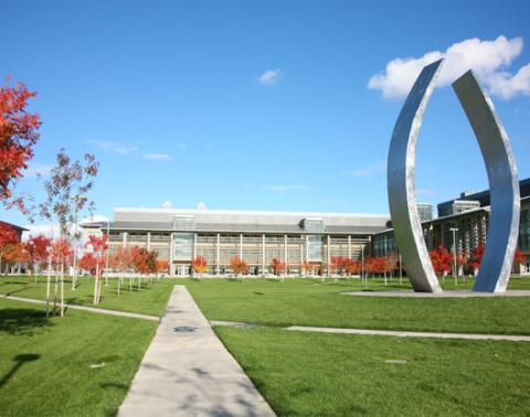 UC Merced campus featuring Beginnings sculpture and Science and Engineering, building 1